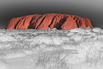 "Uluru, or Ayers Rock, is a massive sandstone monolith in the heart of the Northern Territory's arid ""Red Centre"". - Photograph by H. David Stein"