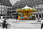 Carousel de la place Gutenberg in Strasbourg, France - Photograph by H. David Stein